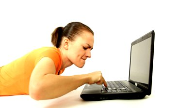 stock-footage-angry-woman-screaming-at-laptop-isolated