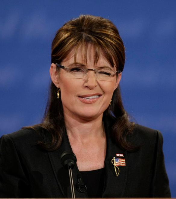 Republican vice presidential candidate Alaska Gov. Sarah Palin winks as she speaks during her vice presidential debate against Democratic vice presidential candidate Sen. Joe Biden, D-Del., at Washington University in St. Louis, Mo., Thursday, Oct. 2, 2008.  (AP Photo/J. Scott Applewhite)